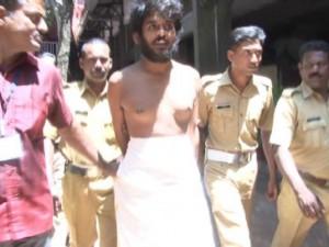 satnam_singh_mann_in_police_custody_in_amritapuri