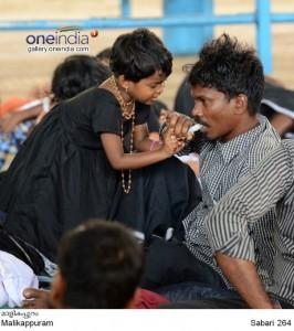 a-child-feeding-prasadam-to-her-father_141766735900